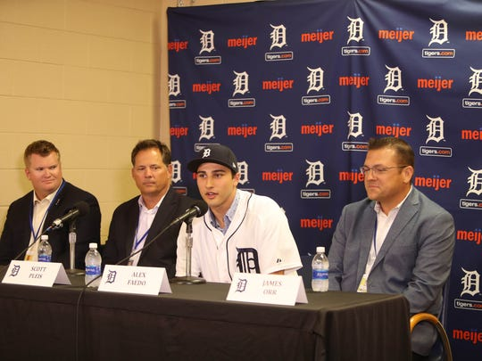 Left to right: Area scout R.J. Burgess, director of amateur scouting Scott Pleis, Tigers first-round draft pick Alex Faedo and area scout James Orr, July 5, 2017 at Comerica Park.