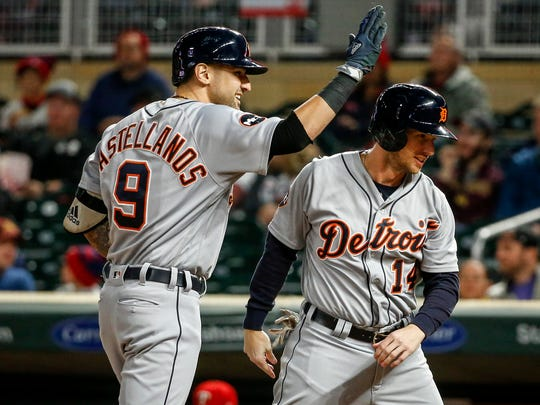 Tigers rightfielder Nick Castellanos (9) celebrates with designated hitter Alex Presley (14) his two-run homer against the Twins in the first inning on Friday, Sept. 29, 2017, in Minneapolis.