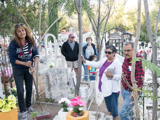 Deportee Karla Gutierrez helps families clean the graves