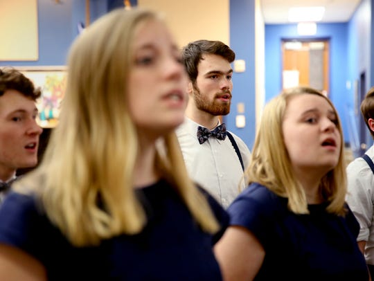 Matthew Albright, center, a senior bass, rehearses with the Something Dangerous a cappella choir at McNary High School in Keizer on Tuesday, Jan. 16, 2018. The group is competing in the International Championship of High School A Cappella Northwest Semifinal on Jan. 26 at the Elsinore Theatre.