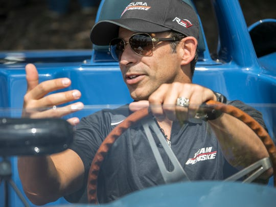Team Penske IMSA racer Helio Castroneves is interviewed inside of a 1963 Chevrolet Covette Grand Sport before The 2018 Chevrolet Detroit Grand Prix presented by Lear media luncheon at the Detroit Yacht Club on Belle Isle Thursday, May 31, 2018.
