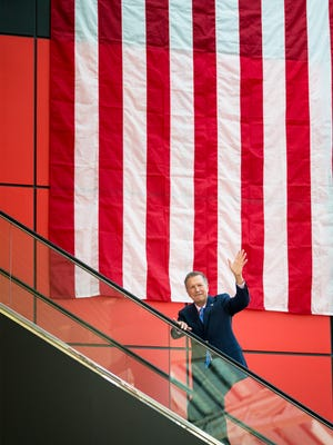 Ohio Gov. John Kasich enters a party at the Rock and Roll Hall of Fame in Cleveland in summer 2016. The party honored Kasich, who ended his presidential bid in May and refused to take part in official Republican National Convention events.