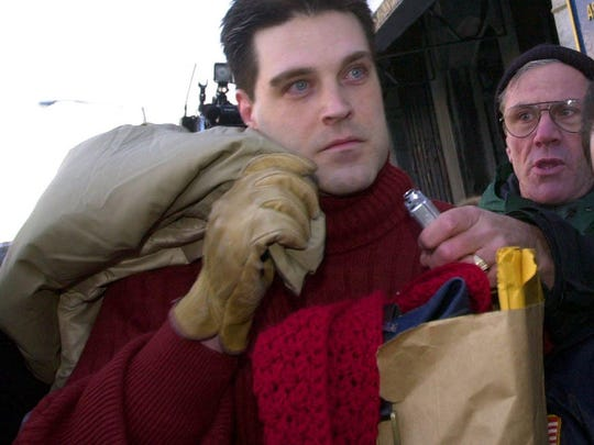 """--**RETRANSMITTED FOR ALTERNATE CROP**Confessed """"Preppie Killer"""" Robert Chambers, left, leaves Auburn Correctional Facility in Auburn, N.Y., Friday Feb. 14, 2003. Chambers served the maximum time on his manslaughter conviction for killing Jennifer Levin on Aug. 26, 1986. (AP Photo/David Duprey)"""
