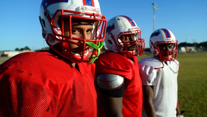 Pine Forest High School football players, from left, Devante Wiggins, Angelo Garay and Ladarius Wiggins.