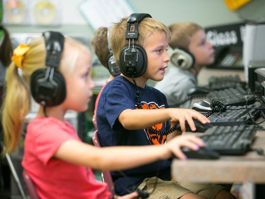 Henry Honcharevich, 6, uses a computer during class