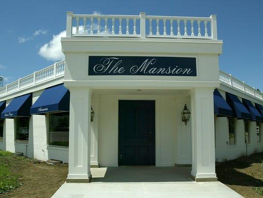 The Mansion fine furniture and interior design store