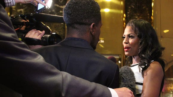 Omarosa speaks to the media at Trump Tower to show