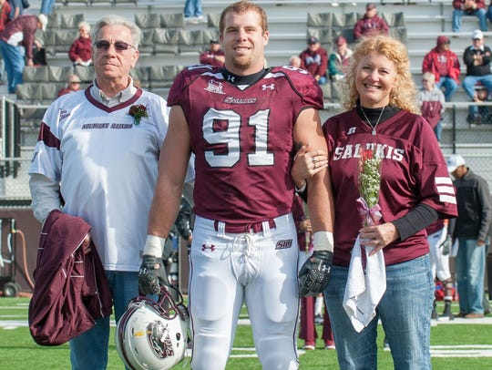 Jason Seaman, center, a Noblesville (Ind.) West Middle School teacher who intervened in a school shooting May 25, 2018, formerly played football at Southern Illinois University.