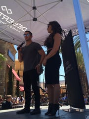 Nick Jonas on microphone and Demi Lovato on right, stop by the Desert Hills Premium Outlets in Cabazon on Wednesday prior to their concert in Anaheim.