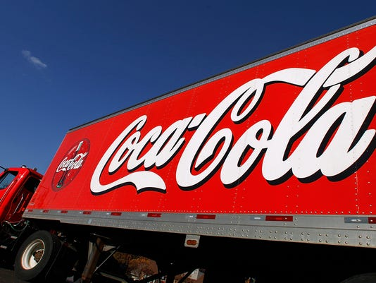 AP EARNS COCA COLA F FILE USA IL