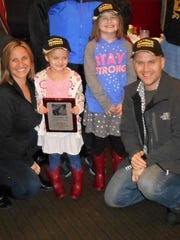 Central Alabama's Vietnam Veterans of America Chapter 607 presented Lilly and her family with a Recognition Plaque after she and other Girl Scouts helped during the VVA's annual flag retirement ceremony at Greenwood Cemetery on Veteran's Day.