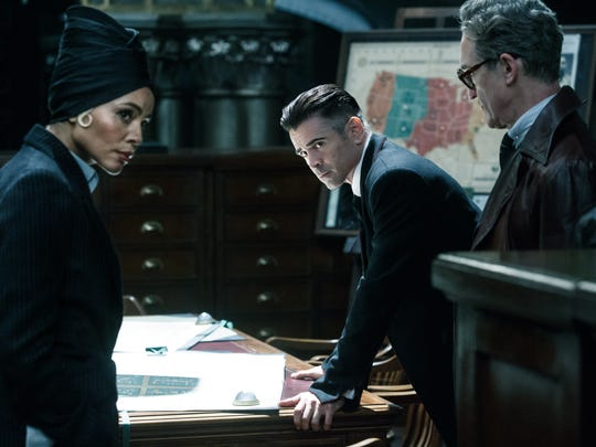 """Colin Farrell (center) stars in """"Fantastic Beasts and"""