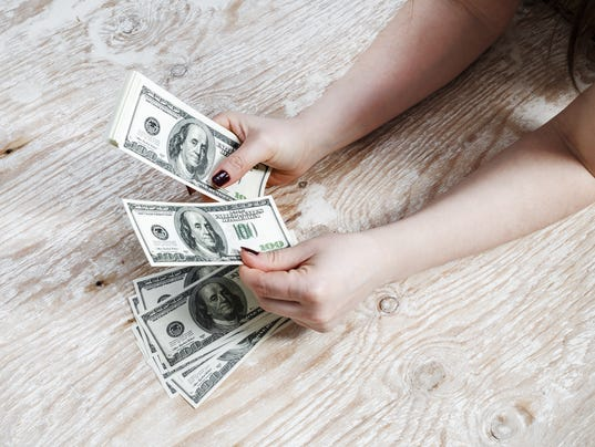 Hands with dollars