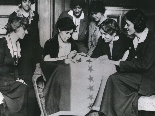 Celebrating ratification of the women's suffrage amendment, Alice Paul (seated second from left) sews the 36th star on a banner in August 1920. The banner flew in front of the Washington headquarters of the National Women's Party, of which Paul was national chairman. The 36th star represented Tennessee, whose ratification completed the number of states needed to put the amendment into the Constitution.