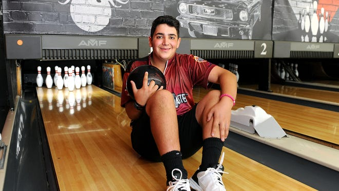 Nate Purches, of Marlborough, is a senior at Assabet Valley Regional Technical High School. He is also a PBA Junior Midwest Regional Champion, who has bowled four perfect 300 games.  Here he's pictured at the AMF Auburn Lanes on Thursday.