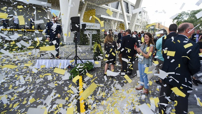 Confetti showers Brightline executives, elected officials and members of the media Jan. 12, 2018, after short speeches were given at the Brightline Fort Lauderdale station. Brightline is selling tickets and passes online and on its mobile app and will begin service for the general public beginning Jan. 13.