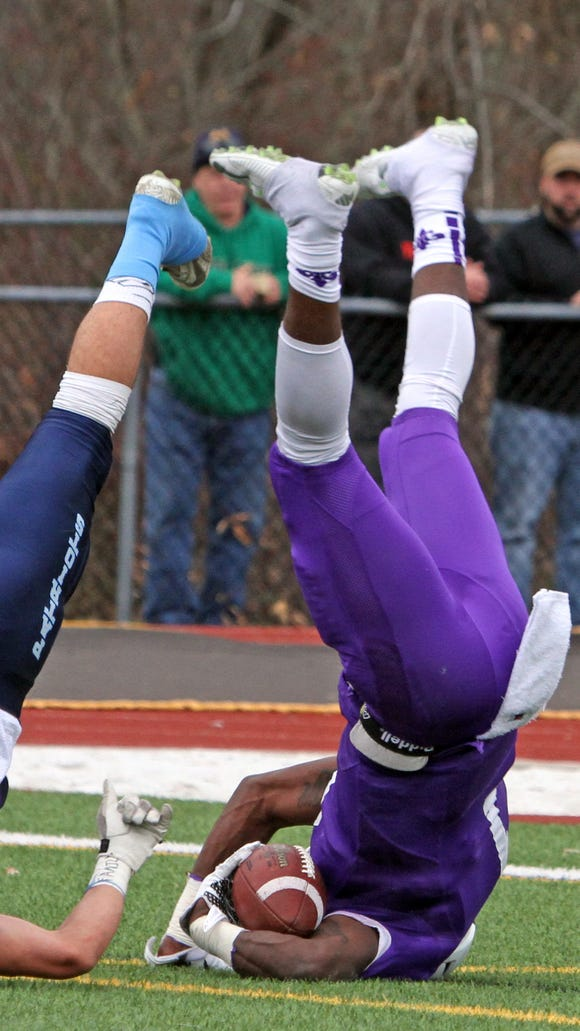 New Rochelle's Rashon McNeil ends up on his head as