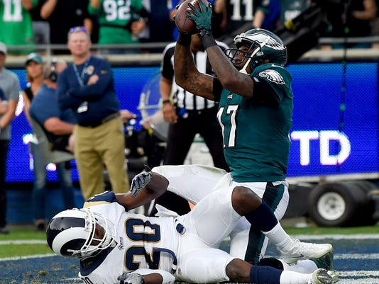 Philadelphia Eagles wide receiver Alshon Jeffery catches a touchdown pass over Los Angeles Rams free safety Lamarcus Joyner during the second half of an NFL football game Sunday, Dec. 10, 2017, in Los Angeles. (AP Photo/Mark J. Terrill)