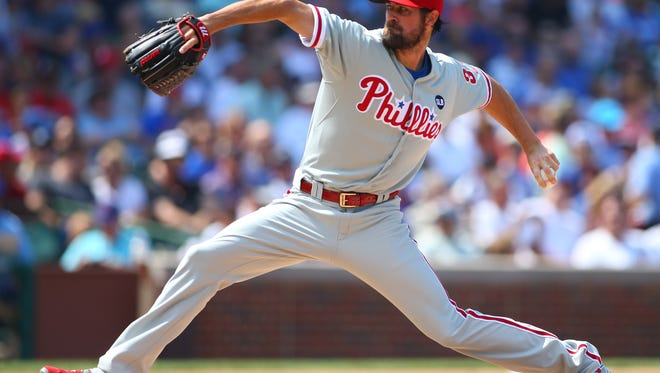 Philadelphia Phillies starting pitcher Cole Hamels throws a pitch during the first inning against the Chicago Cubs at Wrigley Field.