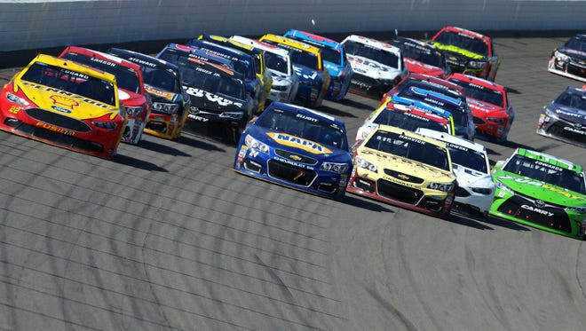 Joey Logano, driver of the No. 22 Shell Pennzoil Ford, leads Chase Elliott, driver of the No. 24 NAPA Auto Parts Chevrolet, in the NASCAR Sprint Cup Series FireKeepers Casino 400 at Michigan International Speedway on Sunday, June 12, 2016.