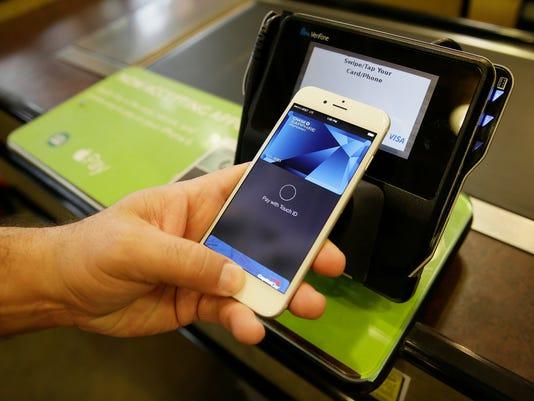 -Apple Pay Retail Skirmish.JPEG-08be5.jpg_20141028.jpg