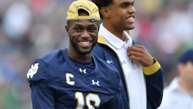 Sep 10, 2016; South Bend, IN, USA; Notre Dame Fighting Irish wide receiver Torii Hunter Jr. (16) and student coach Corey Robinson laugh during warmups before the game against the Nevada Wolf Pack at Notre Dame Stadium. Notre Dame won 39-10. Mandatory Credit: Matt Cashore-USA TODAY Sports
