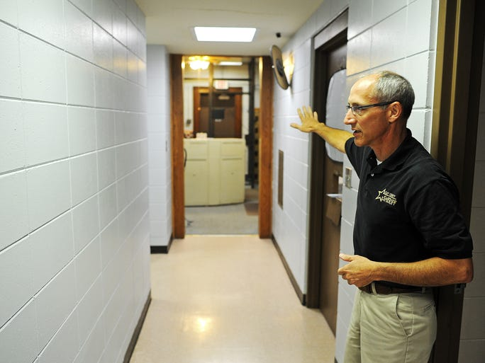 Clay County Sheriff Andy Howe shows an area built in 1989 with three jail cells and a day room on Thursday, July 31, 2014, at the Clay County Jail in Vermillion, S.D. More people with felony drug and alcohol charges are spending time in jail and on probation for their crimes, in part as a result of criminal justice reform.