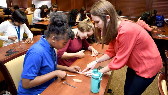 Today, more than ever, teenagers are enrolling in summer school and college classes during the summer because there is simply too much to learn during the regular school year. (Michael Holahan/The Augusta Chronicle via AP) ORG XMIT: GAAUG103