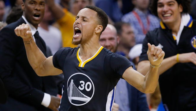 Golden State Warriors guard Stephen Curry (30) celebrates after hitting the game-winning shot against the Oklahoma City Thunder Saturday.