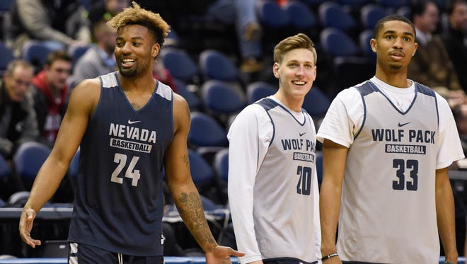 Nevada guard Jordan Caroline (left) and guard David Cunningham (center) and guard Josh Hall practice for their first round game of the NCAA Tournament at BMO Harris Bradley Center.
