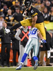 Pittsburgh Steelers tight end Jesse James is upended