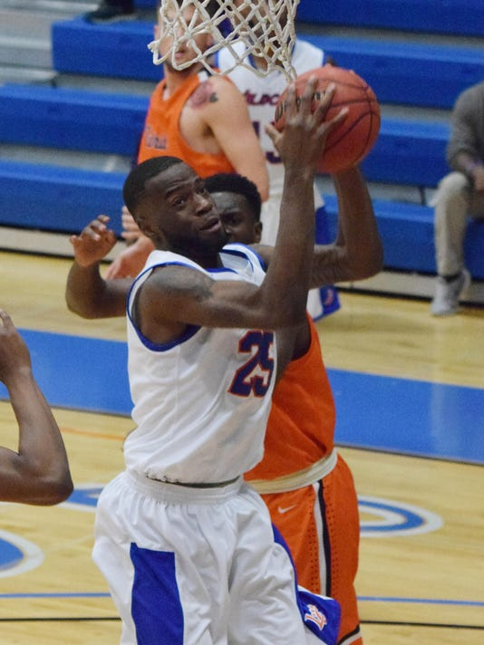 Louisiana College's Clavoisiea Dupree (25, front) goes for two against the University of Texas at Tyler Thursday.