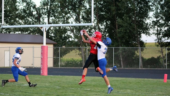 Connor Josephson goes up high for a touchdown for the Cardinals a season ago. Redwood Valley will open up the season Friday night in Windom.