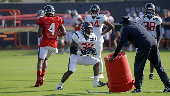In this Thursday, Aug. 15, 2019 file photo, Houston Texans running back Karan Higdon (31) carries the ball during a joint NFL training camp football practice with the Detroit Lions in Houston.