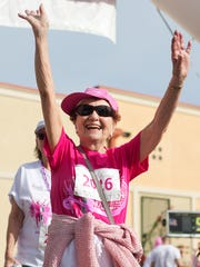Doris Loigman finishes the Susan G. Komen Southwest Forida Race for the Cure at Coconut Point Mall in Estero on Saturday (3/5/16). Loigman, a breast cancer survivor, was among the thousands of survivors and supporters participating.