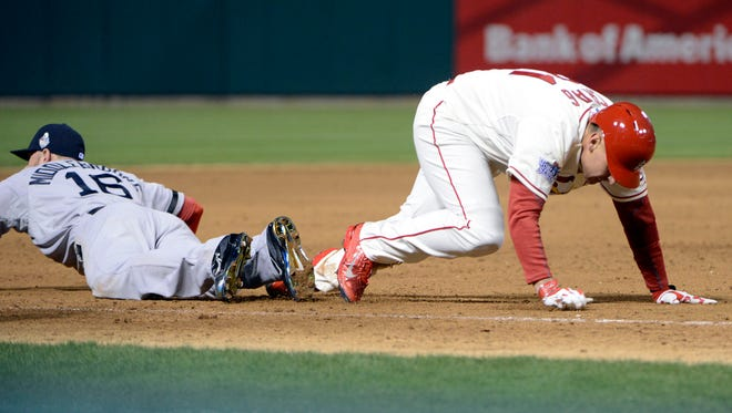 Allen Craig climbs to his feet after stumbling over Will Middlebrooks' during the decisive sequence of Game 3.