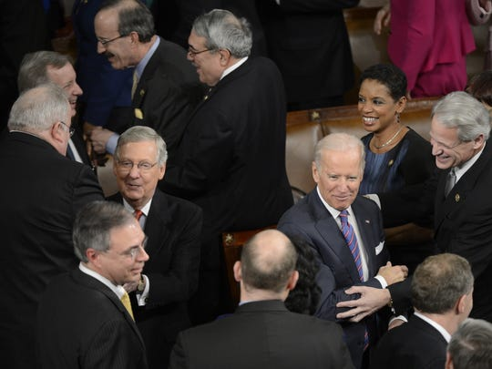 Senate Majority Leader Mitch McConnell, right, and Vice President Biden enter the House chamber for the State of the Union Address on Jan. 20, 2015.