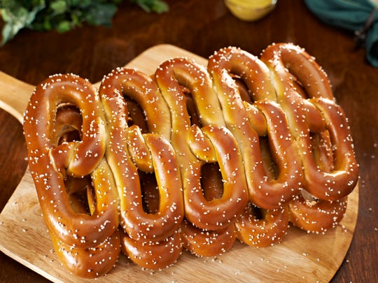 """Philly Pretzel Factory serves """"five-in-a-line"""" pretzels made for sharing, company chief development officer Tom Monaghan said."""