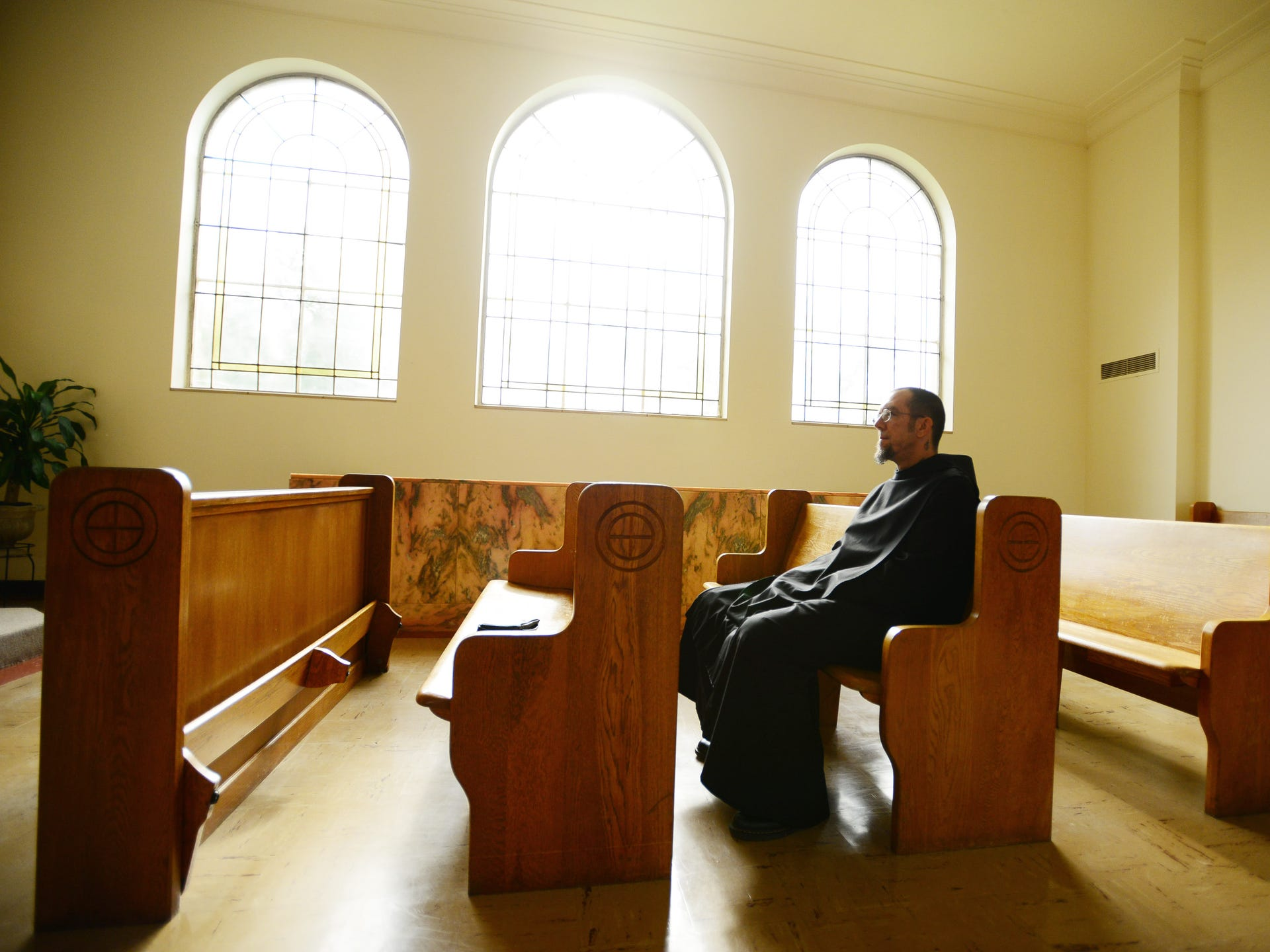 Brother Andre Love, a Benedictine monk, sits in the