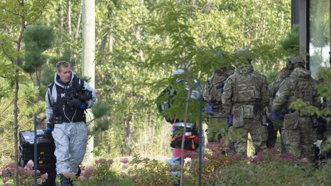 Royal Canadian Mounted Police officers prepare to enter a home Monday in Saint-Hubert, Quebec, in connection with the mailing of ricin to the White House.