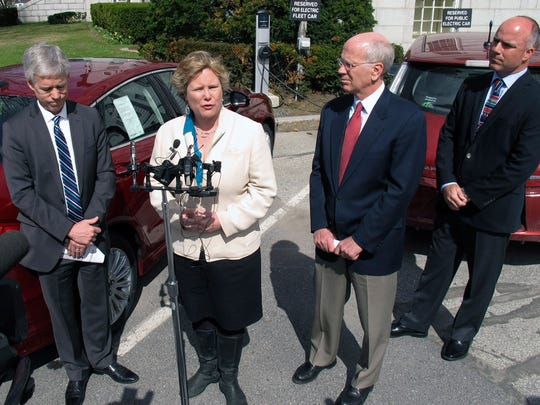 Montpelier Mayor John Hollar, left, U.S. Rep. Peter Welch, second from right, and Dan Keene, right, owner of Lamoille Valley Ford, listen as Karen Glitman, second from left, of the Vermont Energy Investment Corp., speaks about the importance of electric vehicles, Monday, April 28, 2014, in Montpelier, Vt. Welch said he is planning to introduce legislation in Congress to increase the tax credit for the purchase of electric vehicles to up to $10,000 as a way to make it easier for people to buy electric cars.