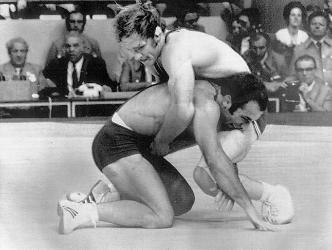 A golden moment: Dan Gable battles Ruslan Ashuraliev