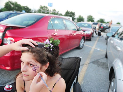 Rachel Horner get her face painted by friend Eve Patterson,