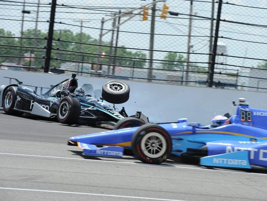 Scott Dixon avoids Josef Newgarden's crash during practice