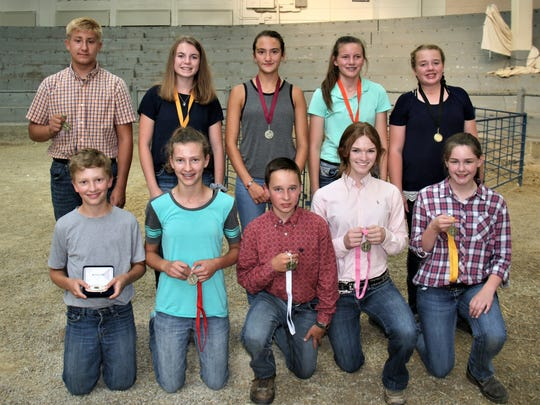 Back row left to right: Trent Laufenberg, Jackson; Samantha Rake, Columbia; Madelyn Thornton, Grant; Emma Steffes, Iowa; Summer Rake, Columbia Earning top ten individual honors in the junior division were (front row from left) Luke Patterson, Grant, 1; Jessica Patterson, Grant, 2; Joey Robinson, Iowa, 3; Cora Capatske, Pierce, 4; and Emily Zukowski, Dunn. 5. Back row from left,  Trent Laufenberg, Jackson, 6; Samantha Rake, Columbia, 7; Madelyn Thornton, Grant, 8; Emma Steffes, Iowa, 9; and Summer Rake, Columbia, 10