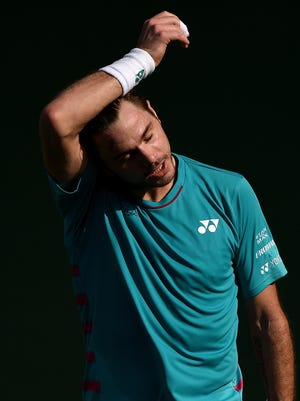 Stan Wawrinka of Switzerland reacts during his match against Damir Dzumhur of Bosnia and Herzegovina on Day 3 of the Dubai Tennis Championship.