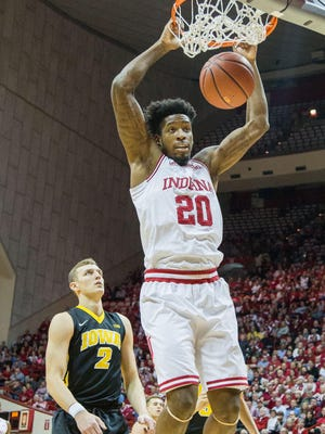 Indiana Hoosiers forward De'Ron Davis (20) dunks the ball as Iowa Hawkeyes forward Jack Nunge (2) defends in the first half of the game at Assembly Hall.