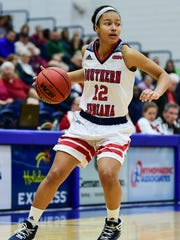 USI's Ashley Johnson (12) looks to make a pass during the fourth quarter against the Missouri Science and Technology Miners at USI's Physical Activities Center in Evansville, Ind., Thursday, Jan. 18, 2018. The Screaming Eagles defeated the Miners, 90-71.