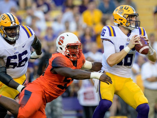 LSU quarterback Danny Etling (16) is sacked by Syracuse