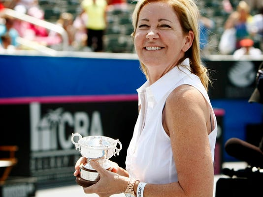 FILE - In this April 21, 2013, file photo, tennis great Chris Evert accepts a replica trophy to honor her Fed Cup achievements as a member of the United States team during the Fed Cup World Group match in Delray Beach, Fla. Evert expects new mom Serena Williams will eclipse the Grand Slam record of 24 singles titles, maybe even this season. Evert also says the name of current record-holder Margaret Court should remain on the arena at the Australian Open despite her controversial views on LGBT rights. (Richard Graulich/Palm Beach Post via AP)